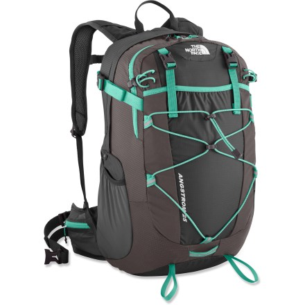 Camp and Hike This ultralight and versatile women's Angstrom 25 pack from The North Face could soon be your fast-packing favorite. Launch your year-round, done-in-a-day adventure with this go-to pack. Dual-density air-mesh shoulder harness and stowable air-mesh hipbelt are shaped for a woman and work in concert with a molded back panel for ventilation and comfort. Panel-loading main compartment contains a padded hydration sleeve (reservoir not included). Huge stretch-woven pocket and bungee system on the front is perfect for raingear or other bulky stuffables. Stretch-woven side pockets hold water bottles (not included) or other often-used items. Built-in raincover stuffs into its own pocket when not in use. Sliding sternum strap features an integrated safety whistle in the buckle. Twin zippered hipbelt pockets hold a few small essentials and are easy to access while pack is on. The North Face Angstrom 25 pack is made of durable ripstop Cordura(R) and ultralight 70-denier ripstop nylon. Closeout. - $80.93