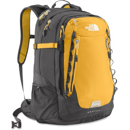 Camp and Hike The North Face Router daypack has the volume to support extended day trips, plus dedicated laptop and tablet compartments to help you ward off withdrawl from the digital world. Ballistic nylon provides a durable barrier to protect your precious cargo during daily use. Zippered padded laptop compartment fits most 17 in. laptops; you can also protect your tablet in its own perfectly sized neoprene sleeve. Injection-molded shoulder straps, with extra top and bottom layers of durable foam, add support and comfort; sternum strap secures the fit and includes integrated whistle. Comfortable, padded air-mesh/polyethylene back panel with spine-relief channel ensures comfort even when carrying heavy loads. Stow the padded winged hipbelt cleanly out of the way when you don't need it. Features large main compartment, large exterior-access organizational compartment, front tricot-lined top stash pocket and 2 vertical stash pockets. Includes a side zippered power-cord pocket and a stretch woven water bottle pocket. Side compression straps secure your load when you're on the move. The North Face Router pack is endorsed by the American Chiropractic Association for the comfort and function of its shoulder straps, back panel and interior organization. Closeout. - $99.93