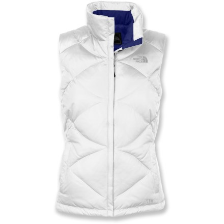 The Aconcagua down vest from The North Face is ready for cold-weather adventures. 550-fill goose down insulation delivers warmth without weighing you down. Downproof, quick-drying, wind-resistant nylon shell is breathable and treated for water resistance. Stand-up collar has velvety soft lining for added warmth; reinforced windflap behind zipper protects against cold air penetration and zipper snags. Drawcord hem helps seal out cold drafts and retains valuable warmth. Zippered handwarmer pockets shelter chilly fingers. Closeout. - $68.93