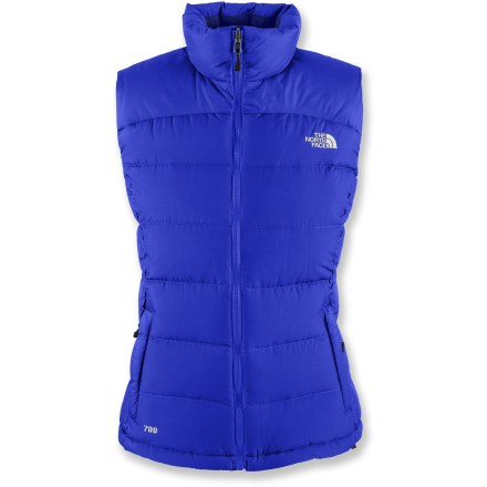 The North Face Nuptse 2 down vest, designed just for women, keeps your core toasty warm with high-loft down that still compresses easily into a stuff sack when packing for a winter excursion. Polyester faille shell fabric is wind resistant, water resistant and downproof. Double-layer taffeta on shoulders increases durability and has a Durable Water Resistant finish that repels moisture. Ample 700-fill-power goose down is extremely warm, lightweight and compressible. Full-length front zipper has an internal draft flap, and collar is lined with soft microfiber. Hem drawcord holds in warmth. The North Face Nuptse 2 features 2 zip hand pockets, 1 of which doubles as a stuff sack; also includes an interior chest pocket. Closeout. - $103.73