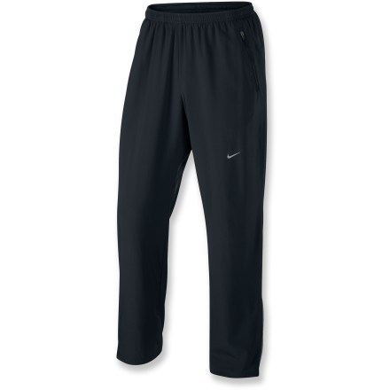 Fitness The Nike Stretch Woven pants offer lightweight, breathable protection that's designed for pushing your limits. Lightweight Dri-FIT(R) stretch knit transports moisture from your skin to the fabric's outer surface for quick evaporation. Comfortable elastic waist with internal drawcord adjusts the fit. Zippered lower legs ease dressing over footwear and adjust ventilation. Contrast mesh insets at the side of legs increase ventilation. Zippered hand pockets store extras. Reflective highlights increase visibility in dim light. Nike Stretch Woven pants offer a relaxed fit. - $65.00