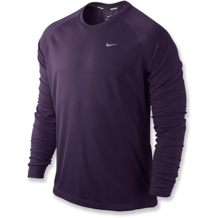 Fitness The Nike Miler UV long-sleeve crew shirt has been brought to you by designers that eat, sleep and breathe performance. It's ready for your toughest run. Recycled Dri-FIT(R) fabric delivers high-tech moisture management to keep you cool and dry, and feels soft and comfortable against your skin. Fabric provides UPF 30 protection from the sun. Mesh side panels increase breathability; raglan sleeves enhance freedom of motion. Reflective highlights increase visibility in low light, and a reflective loop on center back manages earphones cord. The Nike Miler UV long-sleeve crew shirt incorporates flatlock seams for flexibility and comfort. - $42.00