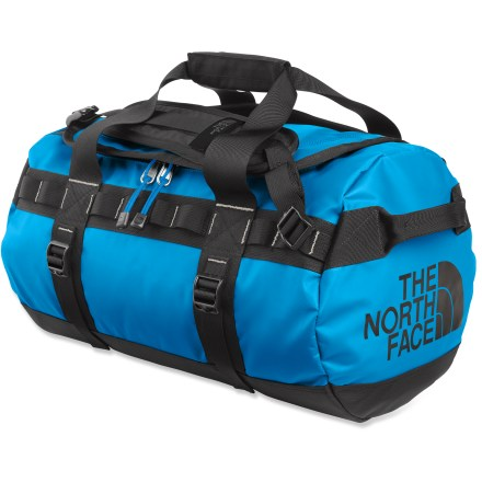 Camp and Hike The X-large Base Camp duffel from The North Face is expedition-ready, thanks to burly construction and cavernous capacity-take the kitchen sink if you want to! Main compartment features a D-shape zippered opening for high visibility and easy access to the interior; internal mesh pocket enhances organization. Duffel-style handles and twin haul handles on ends provide carrying options and can be used for towing or tying down when traveling. Shoulder straps provide comfortable, easy hauling as an occasional backpack. 4 side compression straps secure load and stabilize bag when traveling. Dual daisy chains along sides let you lash on extra gear or tie duffel onto roof, boat or yak. Locking zippers protect your possesions (locks not included); ID pocket on top ensures positive identification. Constructed of water- and abrasion-resistant, 1000-denier polyester with PVC-free thermoplastic elastomer coating to withstand the abuse of travel. Closeout. - $126.93
