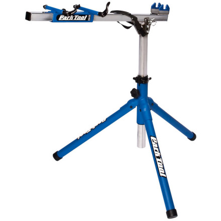 "The Park Tool PRS-20 Team Race Stand is a compact, Euro-style work stand that securely holds your bike without clamping the frame tubes or seat post. Ideal for bikes with ultra lightweight frame tubes and seatposts, and for bikes with tight access areas that can't be clamped. Originally designed for the mechanics of Team Discovery, the PRS-20 is available to professional and home mechanics everywhere. It features quick release mounts that hold the bike securely by the front or rear dropouts. A vinyl-covered cradle and quick release retention strap stabilize the bottom bracket. A 360 degree horizontal rotation allows easy access to both sides of bike, and you can clamp the front fork or the rear dropouts . It folds to 33-inches (84cm) for easy transport and storage. It has a stable tripod base and a built-in ""sleeping hub"" allows easy chain cleaning with rear wheel removed. The bottom bracket height quickly adjusts from 28-inches to 38-inches (71cm to 96cm). It has a durable blue powder coat finish, and high wear parts are chrome plated. - $210.95"