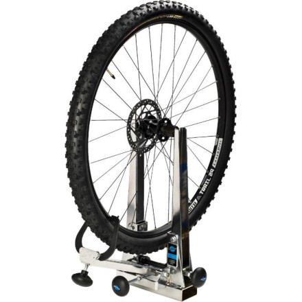"MTB The Park Tool TS-2.2 Professional Wheel Truing Stand is the one to choose for heavy shop use. Alternatively, if you do your own wheel work at home, this is the one you'll want if you appreciate high quality tools and settle for nothing less than the best.The TS-2.2 accepts wheels up to 29"" with or without the tire removed. Both axle-holding uprights move simultaneously, always centering your wheel within the rim calipers, regardless of hub width. The calipers and caliper arm are spring-loaded to prevent jamming with badly out-of-true wheels. It will even accept a four inch wide rim, so if you have a Pugsly, you're in luck. The TS-2.2 also comes with composite caliper tip covers to protect your rims from scratches as you dial in the wheelbuild.The Park Tool TS-2.2 Truing Stand is made of heavy-duty, chrome plated steel with nylon bushings at all the pivot points. It can be bench-mounted or held in a vise.Removable / replaceable composite caliper tips protect your fancy rims from unsightly scratches Accepts hub widths up to 175mm and rim widths up to 4 inches so theres not much you cant straighten Spring-loaded calipers prevent binding Uprights move together to accommodate front and rear wheels Easily installed in a bench vice or mounted on a bench - $234.95"