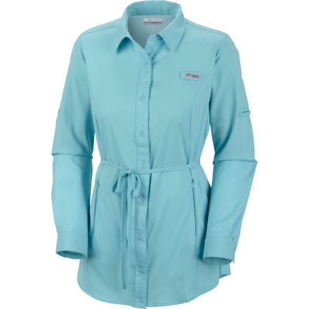 The Columbia Women's Offshore Perfection Tunic offers the ripstop strength, button-down style, and roll-up sleeves of your favorite outdoor shirts, but then ups the ante with a longer length for added coverage, sun protection, and moisture-wicking performance. All this is wrapped up in a modern feminine silhouette with tie waist and vented back. Because with all your hard work and play you, deserve it. - $44.96