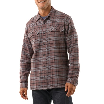 The Patagonia Fjord flannel shirt is warm enough to double as a light jacket on cool fall afternoons. Heavyweight organic cotton flannel has a soft hand for great comfort. 2 chest pockets with button flaps hold everyday items. Includes 2 single pleats on back. Straight hem looks good untucked. Relaxed fit. The Fjord flannel shirt is 100% recyclable through Patagonia's Common Threads Recycling Program-simply return your worn out item to Patagonia. - $59.93