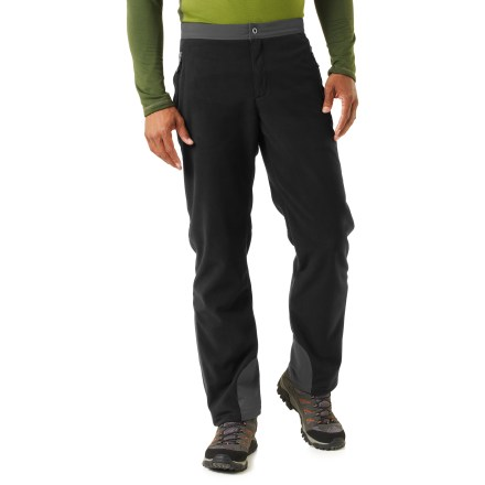 Count on the REI Windbrake Thermal men's pants to provide insulative, wind-resistant warmth. Their smooth, low-bulk cut through the body and legs makes them great for use as a mid layer. Breathable, non-bulky heavyweight polyester fleece has a highly abrasion-resistant face, a wind-resistant laminate and a gridded fleece backing; blocks wind to 50 mph. REI Windbrake Thermal pants insulate even when damp, dry quickly and sport a Durable Water Repellent finish to shed moisture. Waistband is made from woven fabric lined with brushed tricot to ensure a comfortable fit without bulkiness; internal drawcord personalizes the fit. Zip fly with ring-snap closure. Gusseted cuffs feature ankle zippers and rip-and-stick closures to accommodate a variety of footwear; woven fabric at cuffs enhances durability. 2 hand pockets with auto-locking zippers ensure secure closure; zip back pocket. Articulated knees minimize bulkiness and mazimize mobility. REI Windbrake Thermal pants feature an active fit that offers a full range of motion. - $89.50
