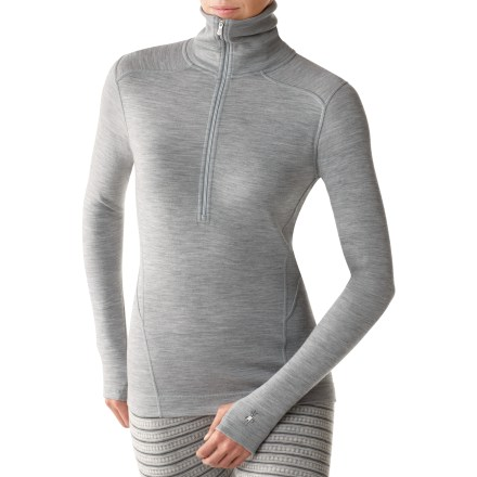 The women's SmartWool Midweight Funnel zip top uses merino wool for excellent moisture wicking performance and sublime next-to-skin softness. With a UPF 50+ rating, fabric provides excellent protection against harmful ultraviolet rays. 14.5 in. front zipper ventilates on demand; raised collar helps keep your neck warm in cold conditions. Flatlock stitching eliminates abrasion, increases comfort and enhances fit by reducing bulky seams. Shoulder panels eliminate top shoulder seams, reduce chafing and offer comfort under pack straps. Thumbholes secure sleeves over hands for warmth. The formfitting SmartWool Midweight Funnel zip top is machine washable. - $79.93