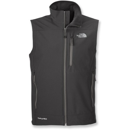 The North Face Apex Bionic vest offers durable windproof protection for your core. Offering solid performance, Apex ClimateBlock stretch laminated fleece is windproof, ultra water resistant and breathable; fleece backer enhances moisture wicking and warmth. Durable Water Repellent finish fends off light rain showers and snow. Windflap backs front zipper, and chin guard protects against zipper abrasion. Drawcord hem cinches to hold in warmth. The North Face Apex Bionic vest features 2 zippered hand pockets and a Napoleon chest pocket. Standard fit allows some layers underneath. - $110.00