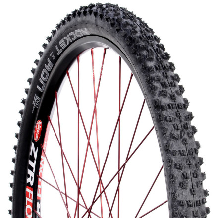 "MTB Its tapered tread lugs give the Schwalbe Rocket Ron TL Ready Tire an uncanny ability to offer traction in mixed conditions, wet or dry. It's especially appealing here because the low weight of the tire underscores its intent as a race tire, designed to get you there first. With the Rocket Ron, you don't have to settle for fast or grippy -- you can have both. Compared to the Racing Ralph, the slightly more prominent blocks have been spaced a bit further apart to achieve more void space. This is part of the reason that it self-cleans in mucky stuff so you can continue to have traction to drive down the trail and keep the bike upright. The Rocket Ron uses Schwalbe's PaceStar Triple Compound, their fastest. Schwalbe engineers recognize that it's not possible for one compound to do it all, so they've combined three to optimize the tire's performance. The low-profile tread of the Rocket Ron is fast, and it's still an excellent cornering tire thanks to the U-Block shoulder tread. These tread blocks are angled at 20 degrees or so towards the outside of the tire. A small sipe doesn't quite divide the block, creating the ""U"" shape. They work to counteract the lateral forces endured when cornering to maintain traction and to keep the bike stable.This tire is designed to be tubeless ready (TL), which means you can say goodbye to pinch flats. A tubeless system allows you to run less air pressure, again enhancing the grip of the tire's tread. Better traction, less vibration, and no flats lead to a great ride. It's necessary to use a liquid sealant within the tire to seal the bead seat and to quickly seal thorn or debris punctures on the trail. The Schwalbe Rocket Ron TL Ready is available in 26 x 2.1, 26 x 2.25, and 26 x 2.4"" widths. Please note: because Schwalbe has optimized this tire to be lightweight, patching in the event of puncture is not recommended.Tubeless 101: The Why and the How Explained. - $68.00"