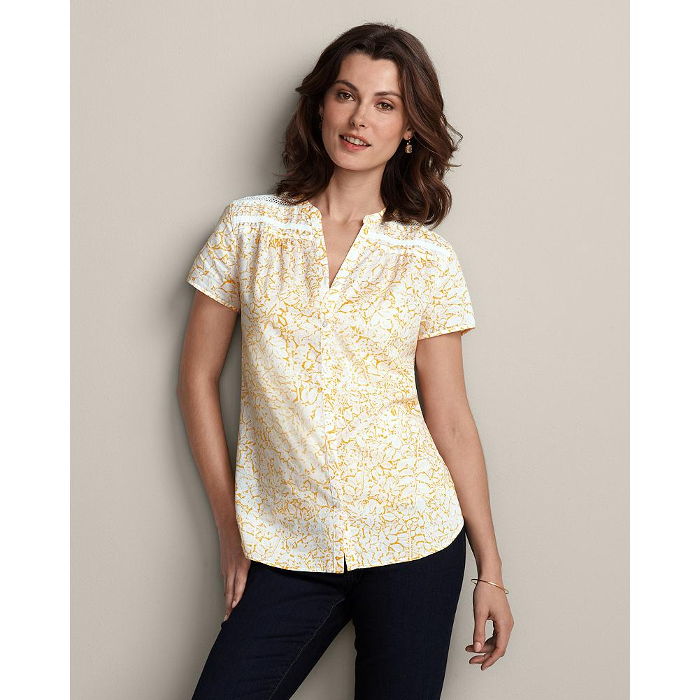 "Eddie Bauer Lace Yoke Print Blouse - An array of thoughtful touches make this comfy creation a favorite you'll turn to again and again. Delicate lace and a floral/leaf pattern, cap sleeves and back darts. Classic fit. Cotton lawn; cami layer recommended. Length, 28"". Imported. - $14.99"