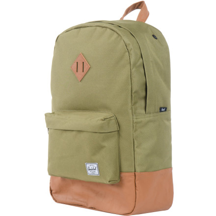 Camp and Hike If you want to look like an attention-needy child, you should shave your head, die your scalp blue, and walk around with a blinking neon-lit backpack. If you want to look like a chill, relaxed individual who has it together, you should wear the Herschel Supply Heritage Backpack. - $54.95