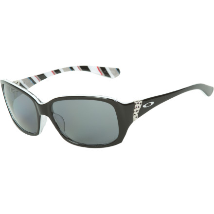 Entertainment Dang girl, you're lookin' mighty fine in the Oakley Women's Discreet Polarized Sunglasses. Looks like those stellar shades prevent the sun's dangerous rays from frying your stunning eyes and keeps the fireball's glare from interrupting your view of the surfers. - $154.00