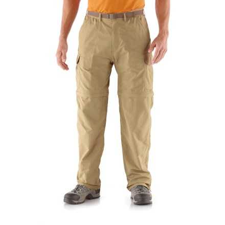 Camp and Hike With a 34 in. inseam, the men's REI Sahara Convertible pants with No-Sit Zips feature an innovative new design that makes converting from pants to shorts and back again easier than ever before! Side zippers run the full length of the lower legs; together with thigh zippers they allow quick conversions without requiring wearer to sit down. They also preclude the need to slip lower legs sections over messy boots when converting from pants to shorts along a muddy trail. Color-coded thigh zippers help you easily tell the right leg from the left leg when converting back to pants. Lightweight nylon fabric dries quickly, resists pilling and is easy to pack away in a backpack. With a UPF 50+ rating, fabric provides excellent protection against harmful ultraviolet rays. Fabric is treated with a durable water repellent finish to repel moisture and stains. Side cargo pockets offer ample space for trail items; also includes front hand pockets, zip coin/security pocket, 1 rear zippered pocket and 1 rear rip-and-stick pocket. Mesh pockets bags enhance ventilation and allow water to drain. Gusseted crotch facilitates freedom of movement for increased comfort. Included webbing belt can be completely removed if desired. Elastic waist helps secure the fit. - $31.83