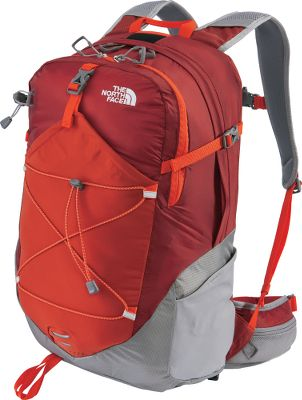 Camp and Hike An ultralight, versatile pack engineered for fastpacking a sport where light weight and carrying capacity are vital to reaching your destination in a desired period of time. Constructed of 210-denier HT ripstop Cordura nylon and 70-denier ultralight 210T ripstop nylon for durability without added bulk. Multiple pockets allow fast, easy access to gear. Stretch-woven front stores a jacket or other article of clothing. A rain cover is stowed in a zippered pocket and deploys quickly to protect pack contents from precipitation. The pack is hydration-compatible with a padded universal sleeve and also has two large, stretch-woven side water-bottle pockets. Heavy-duty YKK zippers. Imported.13H x 8.5W x 20.5D.Capacity: 1,710 cu. in.Wt: 2 lbs.Color: Red Clay/Q-Silver Grey. Gender: Unisex. Color Red Clay/Q-Slvr Grey. Pack Size One Size. - $59.88