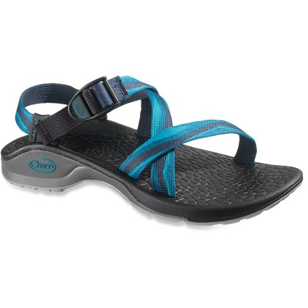 Camp and Hike Get ready for action with these water-friendly Chaco Updraft Bulloo women's sandals. They're designed for a life lived in full pursuit of adventure. Adjustable polyester strapping system uses pull-through design to give you a secure fit while avoiding the bulkiness of extra buckles and straps. Polyester webbing dries faster than nylon, maintaining a uniform fit in all conditions. Sculpted XO3 LUVSEAT(TM) platform offers 20% weight savings over traditional Chaco sandals without sacrificing the reliable arch support. Shaped polyurethane footbeds/midsoles boast thermoplastic urethane frames to deliver ergonomic support posts for an especially lightweight fit. Water-ready Vibram(R) Bulloo nonmarking rubber outsoles feature 2 - 3mm lugging for low-profile, slip-resistant performance. All-synthetic construction makes these Chaco Updraft sandals vegan-friendly. Closeout. - $42.73