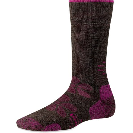 Camp and Hike The SmartWool Outdoor Medium Crew socks feature medium cushioning for all-day support, crew-length height for added warmth and coverage, plus a touch of style to put a little spring in your step. Medium cushioning adds extra comfort and support for full days of walking or hiking. Merino wool wicks away moisture and breathes to regulate temperature for outstanding comfort in a variety of conditions. Extra support under the arches and at ankles improves fit; reinforced bottoms, heals and toes add long-lasting durability. SmartWool socks are guaranteed not to itch and can be repeatedly washed and dried without shrinking. Outdoor Sport Medium Crew socks feature virtually seamless toes for reduced chafing and irritation. Closeout. - $13.93
