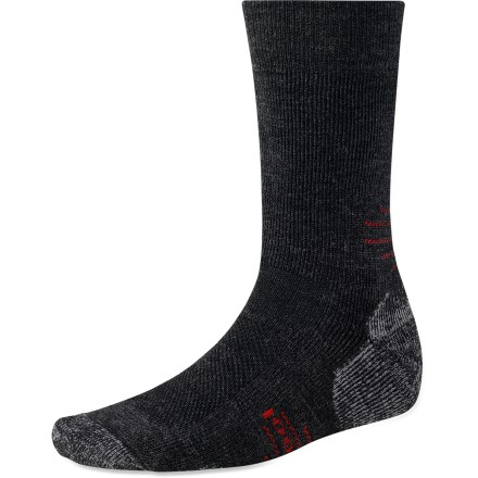 Fitness The SmartWool Outdoor Medium Crew socks feature medium cushioning for all-day support, crew-length height for added warmth and coverage, and the durability to last through every adventure. Medium cushioning adds extra comfort and support for full days of walking or hiking. Merino wool wicks away moisture and breathes to regulate temperature for outstanding comfort in a variety of conditions. Extra support under the arches and at ankles improves fit; reinforced bottoms, heals and toes add long-lasting durability. SmartWool socks are guaranteed not to itch and can be repeatedly washed and dried without shrinking. Outdoor Sport Medium Crew socks feature virtually seamless toes for reduced chafing and irritation. Closeout. - $13.93