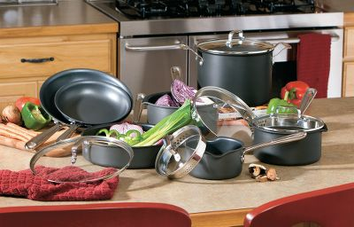 "Created by celebrity chef Emeril Lagassee, this professional-quality, hard-anodized cookware set will spark a culinary revelation in your kitchen. It features a superior, scratch-resistant, nonstick interior and the All-Clad proprietary triple coating. Ergonomic, long-cast stainless steel handles are designed for balance and ease of use. Stainless steel caps and rivets secure handles and are guaranteed for a lifetime. 10-piece set includes 8"" and 10"" fry pans and 1-, 2-, 3- and 6-qt. saucepans with see-through lids. The cookware is not dishwasher safe. Lifetime warranty. - $159.88"