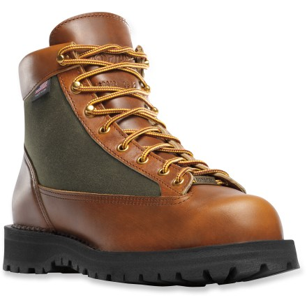 Camp and Hike The limited-release Danner Light 80th Anniversary Edition GTX hiking boots celebrate 80 years of hand-crafted in the USA construction of rugged yet comfortable hiking boots. Horween rich leather uppers offer a premium look and feature waxed canvas quarter panels. Gore-Tex(R) waterproof liners let feet breathe while protecting them from the elements, keeping them dry and comfortable. Nylon linings wick away moisture for all-day comfort. Hand-crafted stitchdown construction offers a wide platform for increased stability on uneven terrain. Airthotic(R) half-length molded polyurethane insteps cup the heels and support the arches. Fiberglass shanks offer the torsional rigidity and stability required when carrying a multiday pack. Vibram Kletterlift rubber otusoles are specifically designed for comfort, stability and shock absportion. Danner Light 80th Anniversary Edition GTX hiking boots feature 4 sets of laces for boot personalization. Danner fit tip: Danner recommends sizing down the Light 80th Anniversary Edition hiking boots 1/2 size for best fit. - $265.93