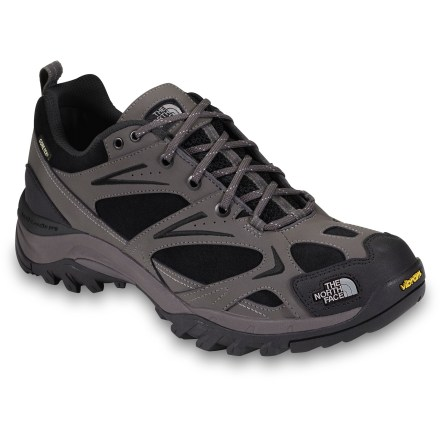 Camp and Hike The North Face Hedgehog Leather GTX XCR hiking shoes offer lightweight construction, a stout, supportive fit and waterproof protection. Leather and suede uppers, backed with Gore-Tex(R) membranes, offer waterproof, breathable protection to keep your feet dry. Biomechanically engineered Northotic(TM) Pro footbeds provide heel and forefoot cushioning pads and extra heel support. Vibram(R) rubber outsole provide excellent traction on varying terrain. The North Face Hedgehog Leather GTX XCR hiking shoes have rubber toe cap to add durability and protection on rough trails. Closeout. - $88.93