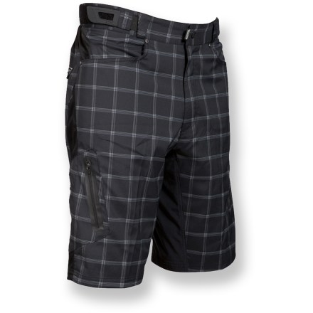 Fitness Don't be fooled by their plaid good looks, the Zoic Ether plaid bike shorts are built to withstand abuse so you can stay focused on cleaning the line ahead. Packed with features, the Zoic Ether plaid shorts are ideal for riding everything from all mountain trails to cross-country outings to urban commutes. Rugged, quick-drying polyester outer shorts endure heavy use and resist abrasion. Removable polyester/spandex stretch-mesh liner shorts wick moisture away and sport a built-in chamois pad. Liner shorts feature a tagless waistline; leg grippers keep liner shorts in place as you move. Men-specific wicking chamois is anatomically molded for comfort in the saddle. Integrated knit mesh panels encourage cooling airflow between outer and inner shorts. Zoic Ether plaid bike shorts feature front hand pockets, 2 leg zip pockets and a hidden back zip pocket. Zippered media player pocket at back thigh features a headphone port and cord-routing loop-perfect for tunes on the go. Attached with an elastic strap inside pocket, included sunglasses wipe is always ready to keep your vision clear. Side rip-and-stick adjuster tabs personalize the fit; waistband secures with snap closure and zippered fly. - $66.99