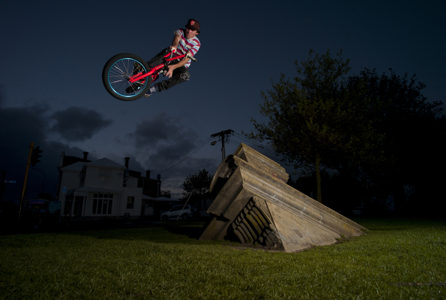 BMX Red Bull NZ rider Louis Bolter with a 180 toboggan off a statue in Auckland, New Zealand