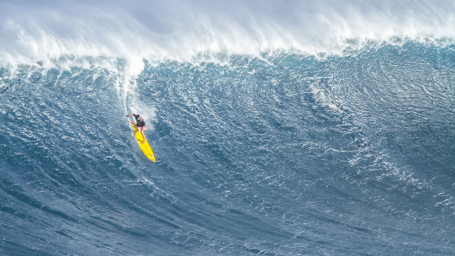 Surf local surfer tyler larronde dropping in at jaws, maui