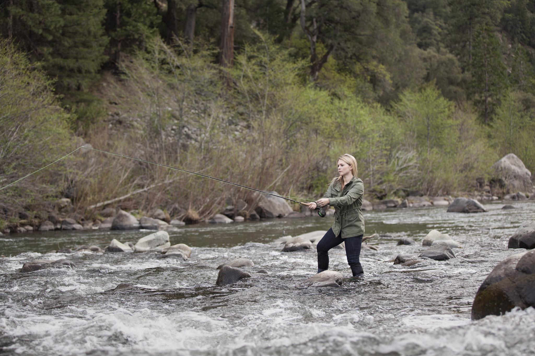 Fly fishing in a fast moving river in the sierra nevada m for Trout fishing northern california