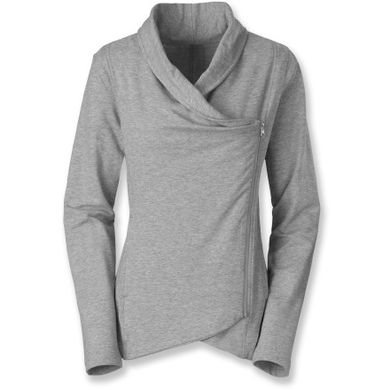 Settle in for a cozy afternoon by the fire or head out for long lunch in the comfort of the Sharlet Wrap sweater by The North Face. Asymmetric full-length zipper with hanging fabric can be worn open like a loose cardigan. Soft cotton feels great next to skin; a touch of stretch ensures flattering shape and fit. Draped collar adds casual elegance. The North Face Sharlet Wrap sweater features a droptail hem for casual shape and style. - $65.00
