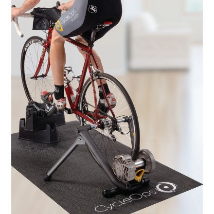 Fitness The CycleOps Fluid2 Bike Trainer and Training Kit give you everything you need to keep in cycling shape even when you can't head out on the roads or trails. Kit includes the Fluid2 bike trainer, 2 climbing riser blocks, training mat, bike thong and a training DVD. Climbing riser blocks support your front wheel and adjusts the angle of your bike to vary the workout. Training mat protects your floor from sweat and bike grime; also helps stabilize the trainer so it will not wander under high-energy efforts. Absorbent cloth bike thong stretches between your handlebars and seat to catch dripping sweat, keeping if off expensive bike parts below. Trainer resistance level varies automatically based on your cadence and wheel speed directly by using your bike's own gears. More power allows for intense interval and strength building workouts. Cooling mechanism increases life of the resistance unit. Power varies from less than 20W to more than 725W (at 22.5 mph). Ideal for hitting and maintaining specific heart-rate targets. The CycleOps Fluid2 Bike Trainer features a patented design that gives you the quietest ride with the best roadlike feel. - $396.00