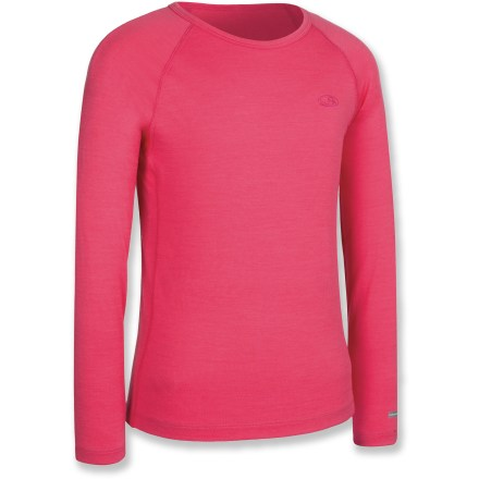 Locking in warmth, the girls' Icebreaker Oasis Crewe top offers kids a comfortable layer of clothing for cold days of playing in the snow and for everyday use. Soft and warm merino wool naturally resists odor. Fabric provides UPF 50+ sun protection, shielding skin from harmful ultraviolet rays. Raglan sleeves enhance fit, allowing freedom of movement. The Icebreaker Oasis Crewe top features flatlock seams that help eliminate chafing. Machine washable; line dry or dry flat in shade. Closeout. - $13.73