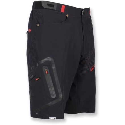 MTB Forming a solid foundation for the demands of tough riding, the Zoic Ether Premium bike shorts stand up to abuse so you can keep focused on cleaning the line ahead. Packed with features, the Zoic Ether Premium shorts are ideal for riding everything from all-mountain trails to cross-country outings to urban commutes. Rugged, quick-drying double-weave ripstop nylon outer shorts endure heavy use and resist abrasion. Removable polyester/spandex stretch mesh liner shorts wick moisture away and sport a built-in chamois pad. Liner shorts feature a tagless waistline; leg grippers keep liner shorts in place as you move. Men-specific wicking chamois is anatomically molded for comfort in the saddle. Integrated knit mesh panels encourage cooling airflow between outer and inner shorts. Zoic Ether bike shorts feature 2 front hand pockets, 2 leg zip pockets and a hidden back zip pocket. Zippered media player pocket at back thigh features a headphone port and cord-routing loop-perfect for tunes on the go. Included sunglasses wipe attached to the pocket is always ready to keep your vision clear. Side rip-and-stick adjuster tabs personalize the fit; waistband secures with snap closure and zippered fly. - $53.83
