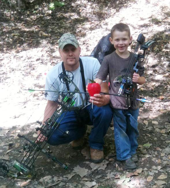 "Submitted by Nikki West Douglas - ""My husband and my oldest son at a local archery shoot. He shoots a Sentinel and my son shoots a Nuclear Ice! Bowtech all the way baby!"""