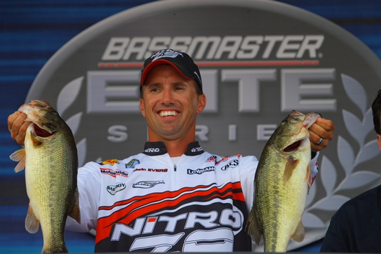 Fishing OPTIMA angler, Edwin Evers shows off some whoppers at a Bassmaster Elite Series weigh-in