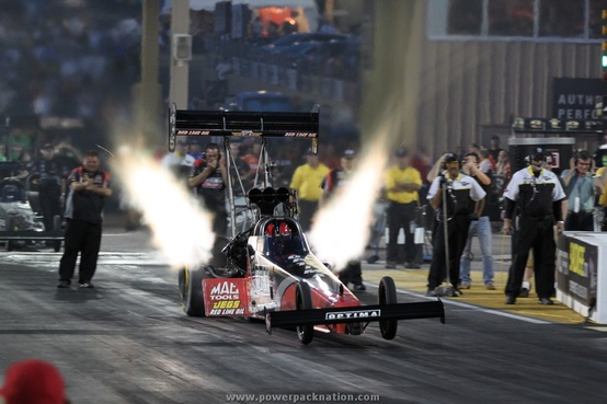 Motorsports David Grubnic's OPTIMA-sponsored @Team Kalitta Top Fuel dragster under the lights in Denver
