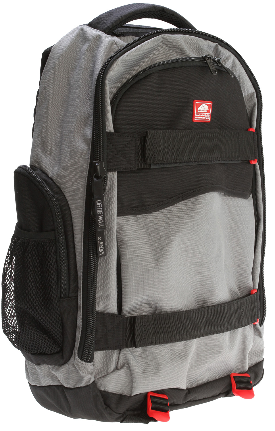 Skateboard Key Features of the Vans Transient Backpack: 600D Poly solid and ripstop, 2x PU-backed fabric - Skateboard straps - Hidden front zippered pocket - Padded air mesh handle - Compression straps at bottom - Fleece-lined media pocket with audio port under handle - Front zip pocket with interior organization - Side zip pockets - Side mesh pocket - Sternum strap - Large rubber heel tab on front - Logo zipper pulls - $34.95