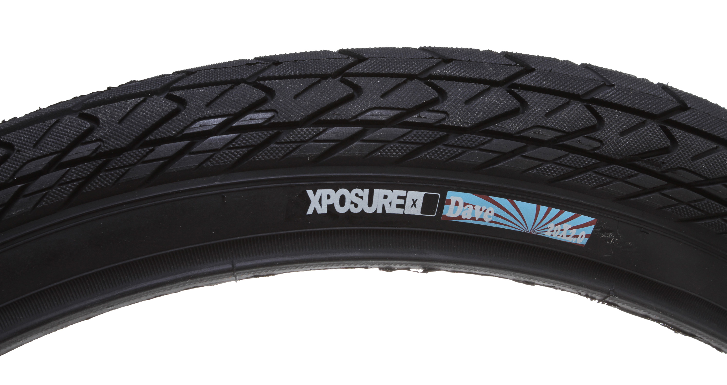 "BMX Key Features of the Xposure Dave Tire 20X2"": Material: Rubber Size: 2.125″ Colours: Black / Gum wall / White wall / Red wall Description: wrap around less aggressive tread patter , faster rolling ideal for the back, 60 psi construction Weight: N/A - $17.95"