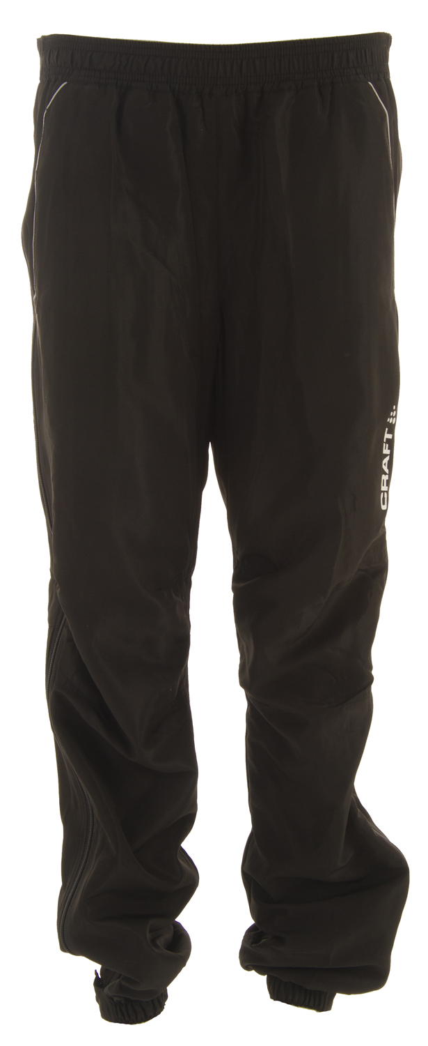 Ski Key Features of the Craft AXC Touring Pants: Warm And Looser Fitting Training PantWindprotective Shell FabricFull Side Two Way ZipperTwo Side PocketsReflective Logo Print - $62.95