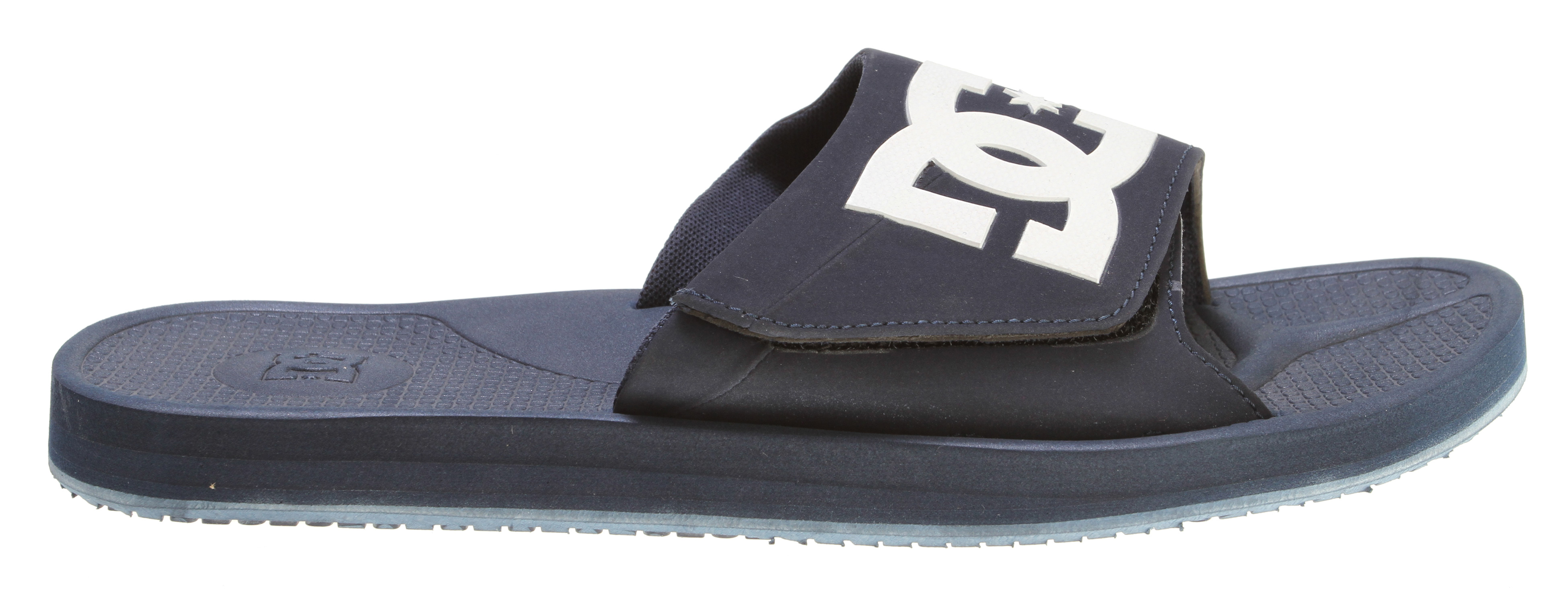 "Skateboard Key Features of the DC Graffik Slide SN Sandals: Nubuck or leather upper with large DC logo Adjustable hook and loop closure Comfortable EVA footbed Soft lining DC's trademarked ""Pill Pattern"" rubber outsole - $24.95"