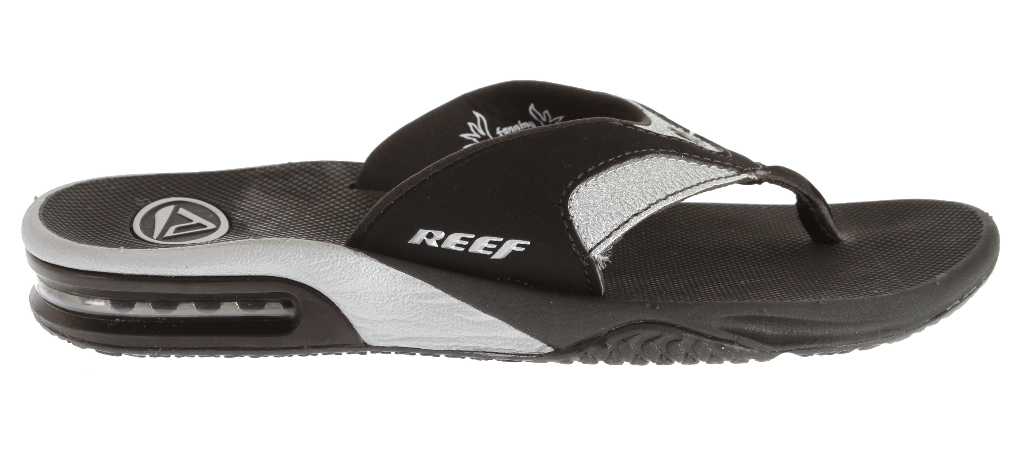 Surf Shoot the breeze on the beach in these glittery Fanning Luxe flip-flops by Reef, inspired by pro surfer Mick Fanning.Key Features of the Reef Fanning Luxe Sandals: Foam rubber upper in a casual thong sandal style with a round open toe and rolled toe thong post Logo detail Textile lining and cushioning foam rubber textured footbed Flexible midsole with a gel cushioned heel Rubber traction outsole with a built-in bottle opener 1 inch wedge heel - $53.95