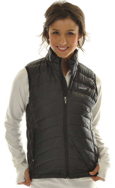 Ultralight, windproof, and toasty warm, the Women's Down Sweater Vest is highly compressible insulation with a 100% recycled polyester shell. It works as a midlayer or as outerwear in chilly climates. Simple, lightweight core warmth. This vest's minimalist design practically floats; its 800-fill-power down traps heat in alpine conditions, and it's so compact it stuffs into a stretch-mesh internal pocket (with a carabiner clip-in loop). The innovative 100% recycled polyester shell with a Deluge DWR (durable water repellent) finish provides wind and water protection as well as a high tear-strength; quilting stabilizes the down. With zippered handwarmer pockets and a drawcord hem.Key Features of the Patagonia Down Sweater Vest: Superlight, windproof shell has high tear-strength and is treated with a Deluge DWR (durable water repellent) finish Quilted construction stabilizes 800-fill-power premium European goose down Pockets: two zippered handwarmers, one zippered stretch mesh stuffsack pocket with a reinforced carabiner clip-in loop Elastic binding at armholes Drawcord hem seals in warmth, seals out wind Shell and lining: 1.4-oz 22-denier 100% recycled polyester with a Deluge DWR (durable water repellent) finish. Insulation: 800-fill-power premium European goose down 260 g (9.2 oz) Made in China. - $92.95