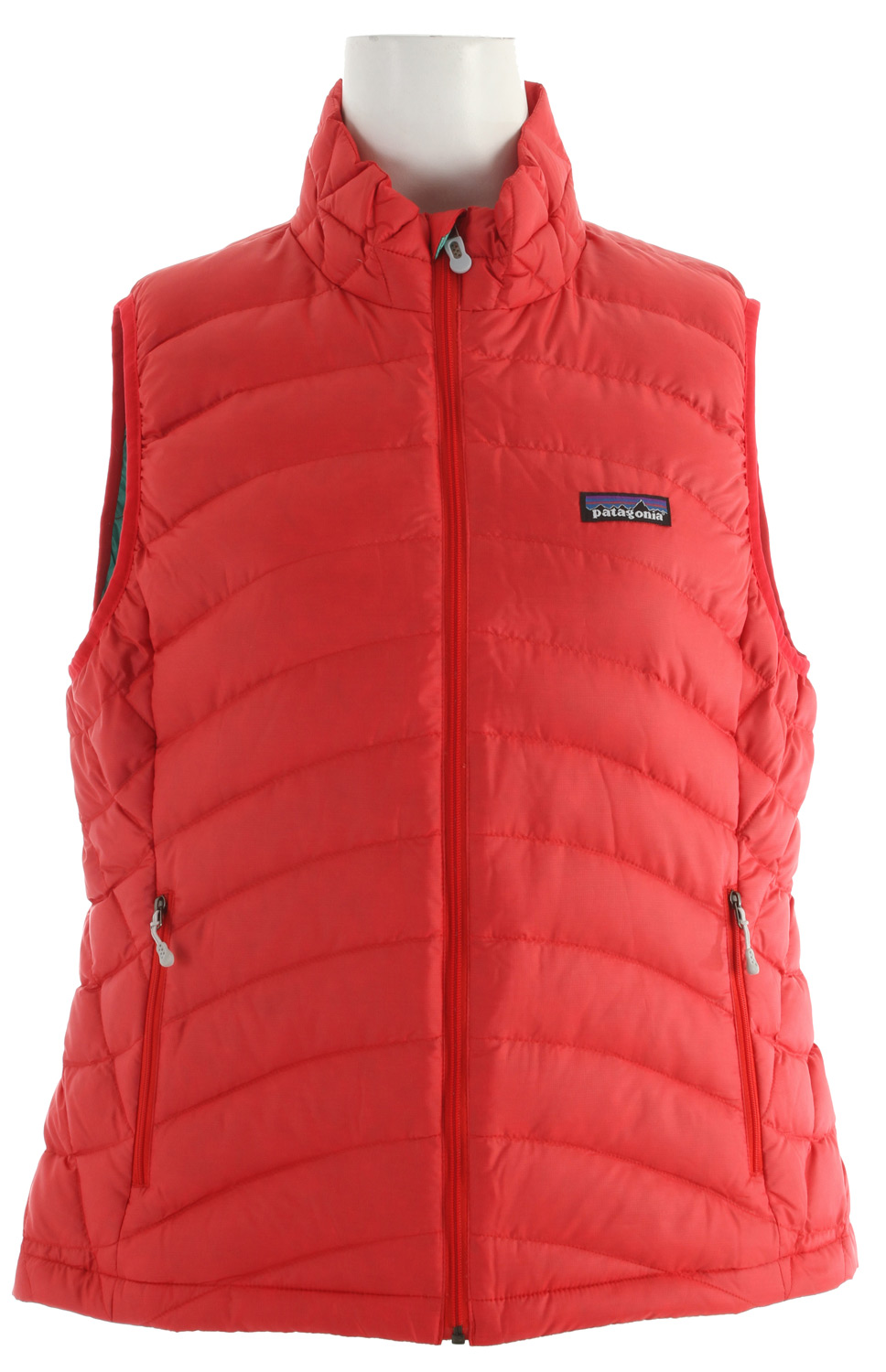 Ultralight, windproof and toasty warm, the Down Sweater Vest is highly compressible insulation with a 100% recycled polyester shell; ideal as a midlayer or as outerwear in chilly climates. This garment has a Slim Fit The light, high-lofting feathers in this Vest float just off your core, trapping heat without you knowing anything's there. Until, of course, you take off the Vest (and quickly put it back on). Its 800-fill-power down seals in warmth, and it's so compact it stuffs into a stretch-mesh internal pocket (with a carabiner clip-in loop). The innovative 100% recycled polyester shell with a Deluge DWR (durable water repellent) finish provides wind and water protection as well as high tear-strength; quilting stabilizes the down. With zippered handwarmer pockets and a drawcord hem.Key Features of the Patagonia Down Sweater Vest: Superlight, windproof shell fabric with high tear-strength has a Deluge DWR (durable water repellent) finish Quilted construction stabilizes 800-fill-power premium European goose down Zippered pockets: Two handwarmers, one stretch mesh stuff-sack pocket with a reinforced carabiner clip-in loop Elastic binding at armholes Drawcord hem seals out wind Shell and lining: 1.4-oz 22-denier 100% recycled polyester with a Deluge DWR (durable water repellent) finish. Insulation: 800-fill-power premium European goose down 260 g (9.2 oz) Made in Vietnam. Recycled Polyester: We recycle used soda bottles, unusable second quality fabrics and worn out garments into polyester fibers to produce many of our clothes. Deluge DWR: Patagonia's proprietary durable water repellent fabric finish, Deluge DWR, lasts substantially longer than standard DWRs. Garments with the Deluge DWR finish have like-new repellency after years of extensive use. - $105.95