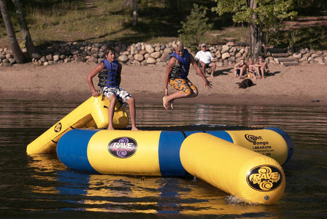 Fitness For fun on the run, play the Bongo. Put a lightweight bounce platform into the trunk or boat and go wherever adventure leads you. Relax away your summer knowing that RAVE provides a lifetime warranty guarding you against manufacturer's defects. The Bongo inflates quickly, anchors effortlessly and allows you to lounge or bounce anywhere there is water. Each Bongo model comes with a durable boarding ladder designed with steps deep into the water, hand holds molded into each step, and boarding assist handles at the top enabling anyone to board effortlessly.Key Features of the Rave Bongo Water Bouncers 13 with Slide And Log: Includes Bongo Bouncer 13, Aqua Slide Small, Aqua Log Small Will hold 2 bouncers Bounce surface: 9 feet Water depth required: 8 feet Height 24 in. - $1,599.99