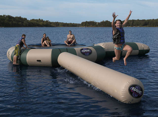 "Answer the call for quality family fun with an Aqua Jump, the original water trampoline. Whether you are six or sixty, no other product inspires happiness quite like it. And no other company builds water trampolines better than RAVE Sports. Each size Aqua Jump comes with a stainless steel ladder designed with steps deep into the water, easy to grip stainless steel bars, hand holds molded into each step and boarding assist handles at the top enabling anyone to board effortlessly. Relax away your summer knowing that RAVE provides a lifetime warranty guarding you against manufacturer's defects. 36"" high, 10 feet jumping surface, allows for 2 adult jumpers. Comes with trampoline, launch, and log. - $3,699.95"