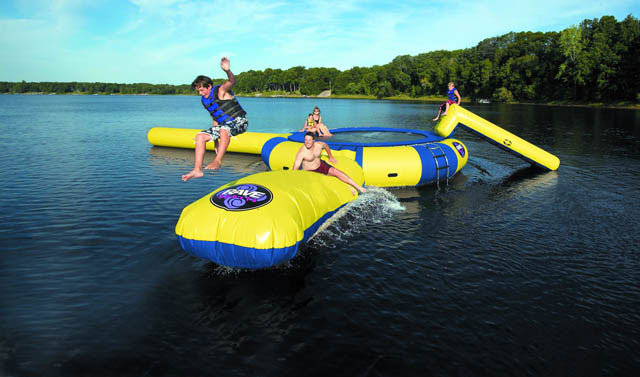 "Answer the call for quality family fun with an Aqua Jump, the original water trampoline. Whether you are six or sixty, no other product inspires happiness quite like it. And no other company builds water trampolines better than RAVE Sports. Each size Aqua Jump comes with a stainless steel ladder designed with steps deep into the water, easy to grip stainless steel bars, hand holds molded into each step and boarding assist handles at the top enabling anyone to board effortlessly. Relax away your summer knowing that RAVE provides a lifetime warranty guarding you against manufacturer's defects. 36"" high, 14 feet jumping surface, allows for 3 adult jumpers. Comes with trampoline, launch, and log. Does not include Slide shown in picture. - $4,699.99"