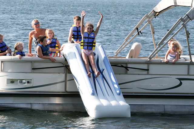 "Family fun in a way that you have never before experienced! Put a patent pending RAVE Sports Pontoon Slide onto your pontoon boat and add a new dimension to boating fun. Entertain all ages with this rugged commercial grade inflatable slide that requires only a couple of minutes to set up. Place it over the side gate of the pontoon boat, inflate with the included 12V pontoon boat battery powered inflator/ deflator, secure to the exterior rail with 4 attached straps and begin sliding away. 1 Slider. 8ft* Material: PVC * Size: 10' x 25"" x 68"" * Weight: 30 lbs * Set-Up: 5 minutes * Minimum Depth: 5' * Included: 4 inset molded foot steps; 2 molded vinyl assist handles; 12V high pressure inflator/deflator * Note: Compact for easy storage in a cooler, duffle or under the seat. Rolls up to the size of a sleeping bag! - $399.95"