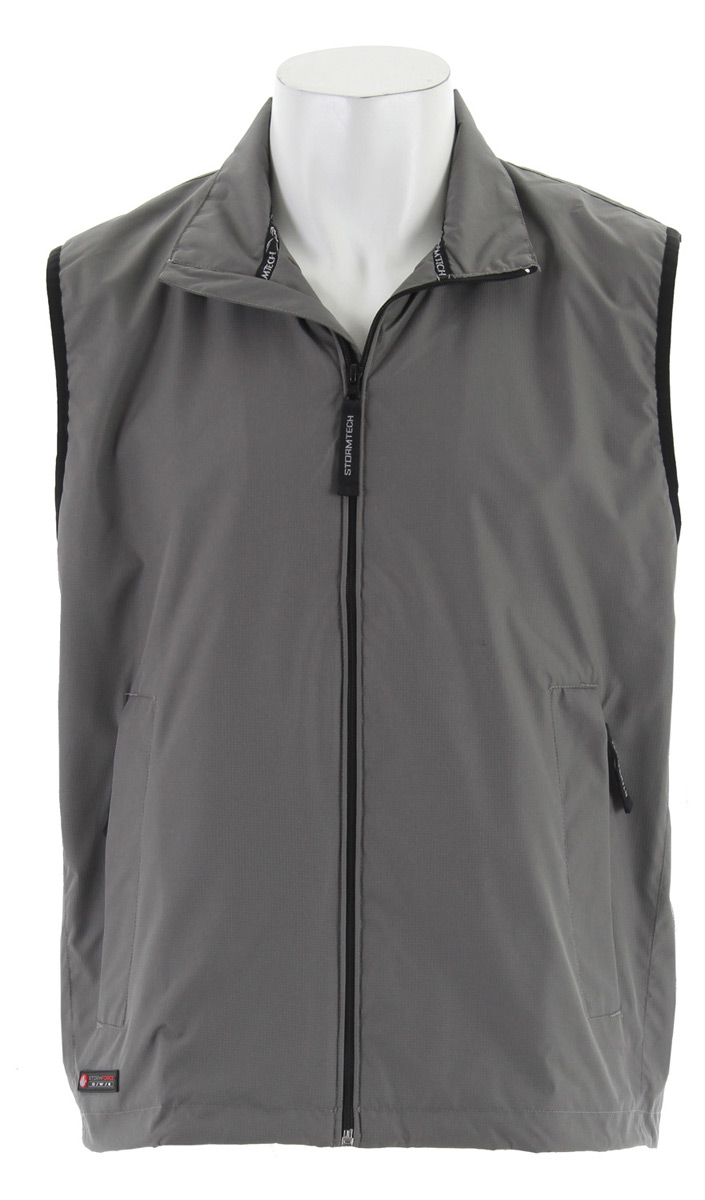 On those cool, damp mornings, the Fleet Ripstop vest is just enough protection to keep your core heat where it belongs. Layer it over your favorite sweater in the fall or toss it over a tee in the spring.Key Features for the Stormtech Fleet Ripstop Vest: Durable STORMTECH DWR 100% Polyester micro ripstop outer shell/mesh lining Packs into a self pocket Full-length external draft flap Stand-up storm collar on shell Concealed rollaway hood Adjustable elastic drawcord hem Front zipper pockets Inner security pocket with zipper - $18.35