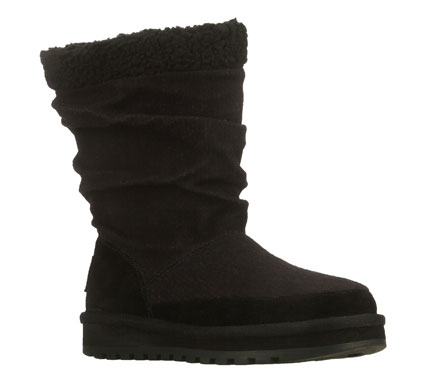 Keep the good feelings going with the SKECHERS Keepsakes - Warm and Fuzzies boot.  Soft sweater knit fabric upper in a mid calf height slip on cool weather casual boot with stitching and overlay accents.  Shearling-style collar trim. - $70.00